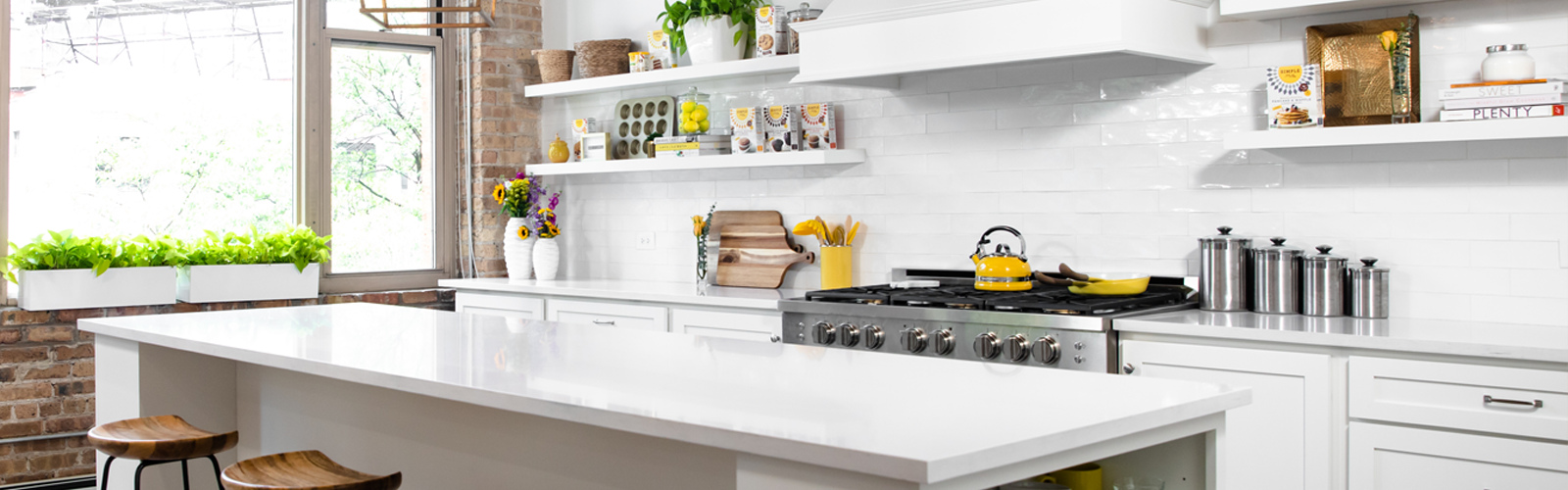 All white bright airy kitchen with yellow accents and Simple Mills products on shelves