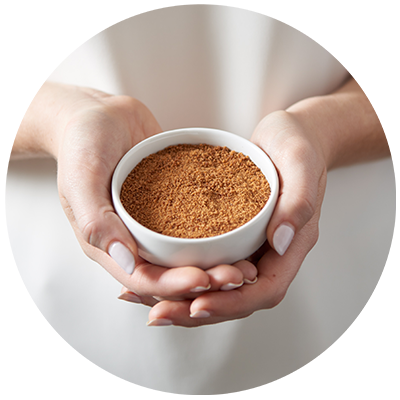 Coconut Sugar ingredient being cradled in bowl in hands, nothing artificial ever