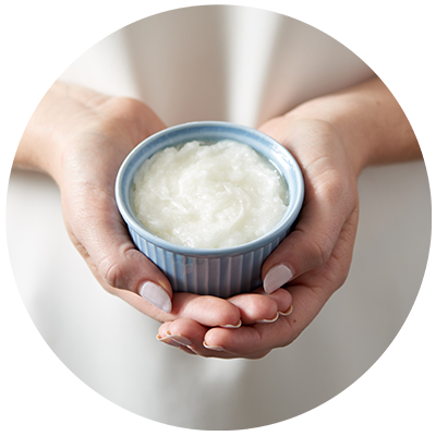 Coconut Oil ingredient being cradled in bowl in hands, nothing artificial ever