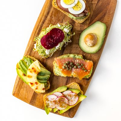 Avocado-Toast,-top-down,-close-up,-all-variations,-angled,-wooden-board.jpg